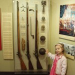 My assistant again showing off some muskets and cannon balls.